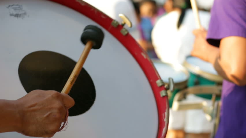 A man playing the drum with the bands