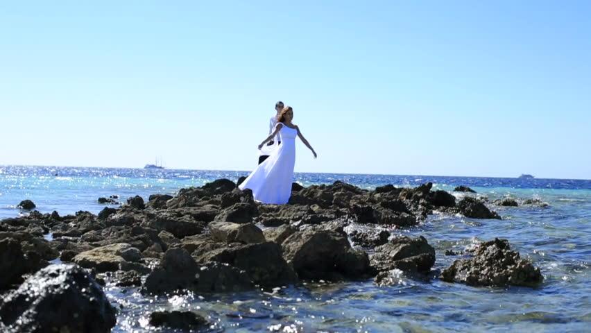 Beautiful newlyweds posing on the stoned seashore in Egypt. Beautiful honeymoon   Shutterstock HD Video #15226195