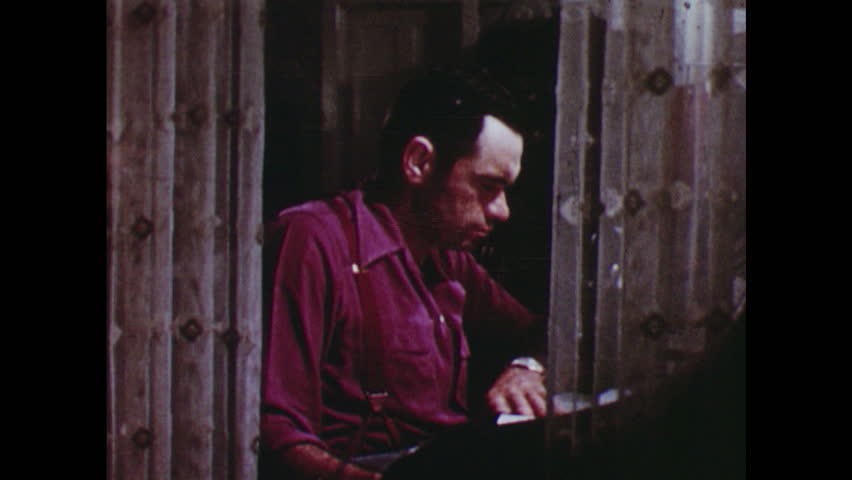 UNITED STATES 1950s: Man sitting at desk reading - HD stock footage clip
