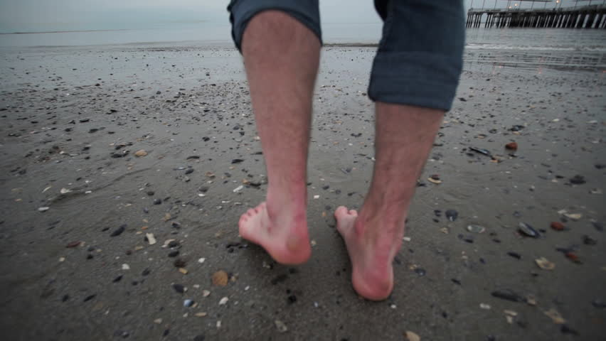 A POV shot of a man walking  on the beach. | Shutterstock HD Video #15241063