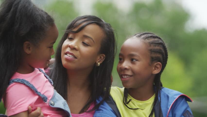 4K Portrait of happy African American mother & children having fun in the park | Shutterstock HD Video #15243538