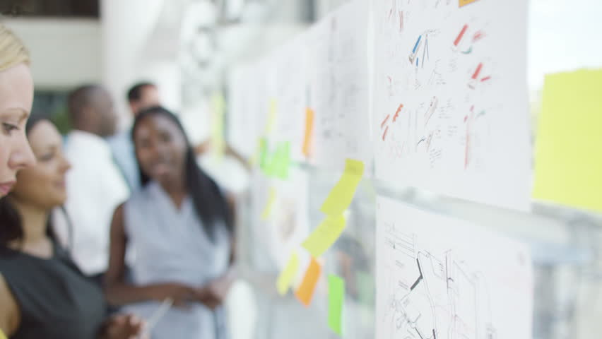 4K Female creative design team brainstorming for ideas with sticky notes - 4K stock footage clip