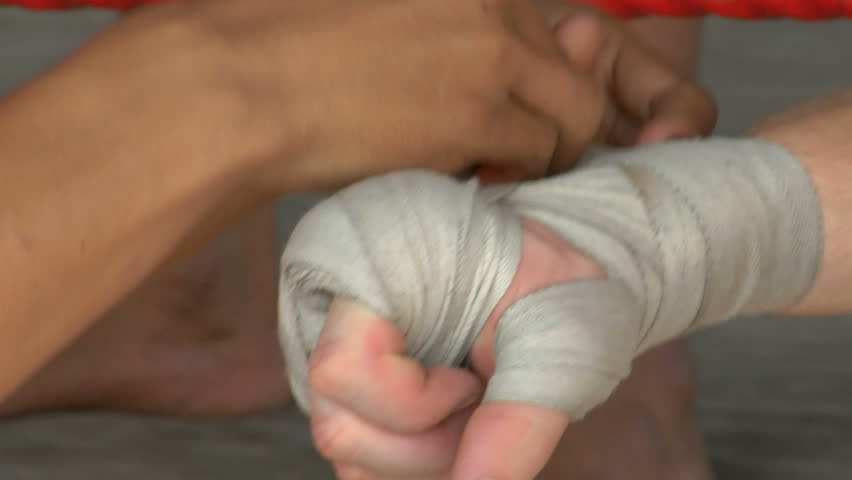 Thai kick boxer having his hands bound before a fight.  - HD stock footage clip