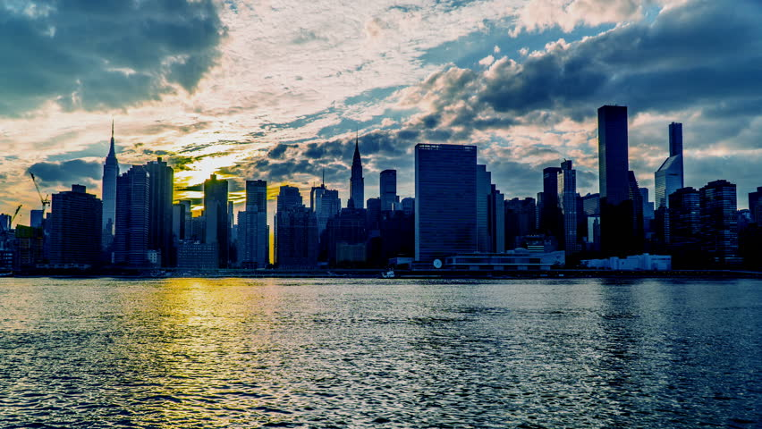 New York City, USA-Jul 10,2015: At sunset, the Manhattan skyline, New York City, NY | Shutterstock HD Video #15329740