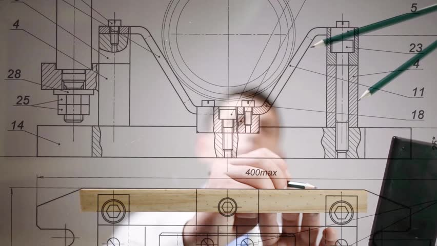 Drawings are on the desktop, hands of engineer drawing by pencil