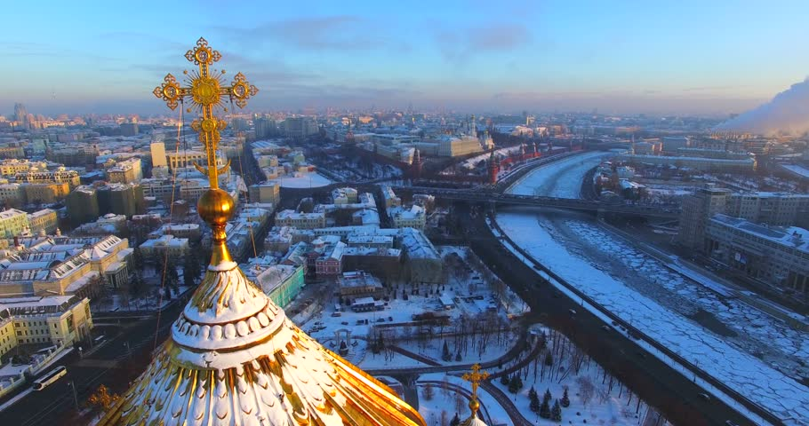 Aerial view of the impressive Cathedral of Christ the Saviour in Moscow, Russia. The original church, built during the 19th century, not it's the tallest Orthodox Christian church in the world. Winter - 4K stock footage clip