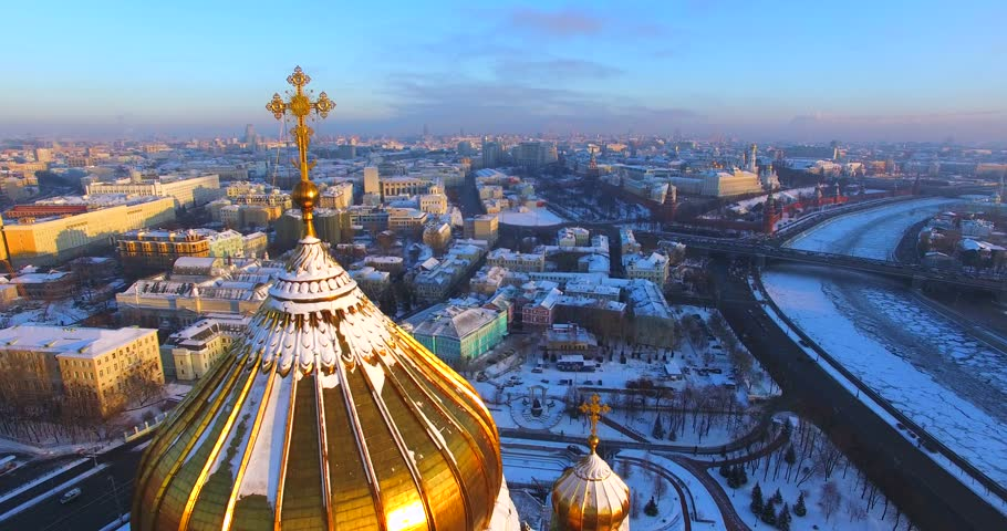 Great close aerial view of the Cathedral of Christ the Saviour, its gilt domes and crosses. Descension. It was originally commissioned after the defeat of Napoleon in 19th century. Moscow, Russia - 4K stock video clip