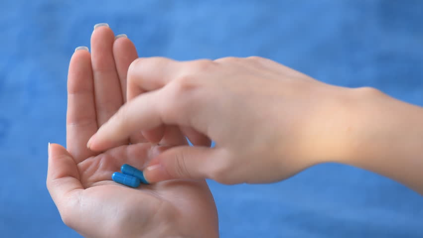 Young female taking medicine pills - HD stock video clip
