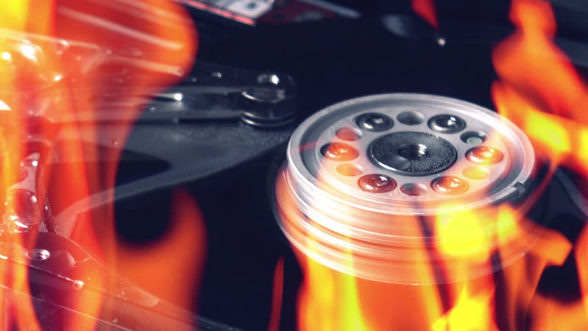 Hard disk failure, computer hdd on fire, burning in flames, data loss and computer technology crash concept.