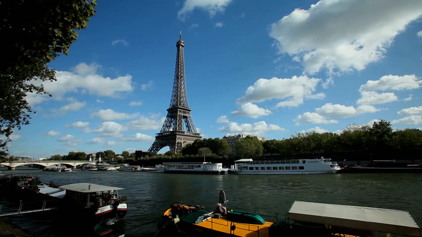 PARIS - OCTOBER 2012: Timelapse of boats on seine river and eiffel tower on October 12, 2012 in Paris, France. The Eiffel Tower is the most visited tourist attraction in Paris. | Shutterstock HD Video #15580228