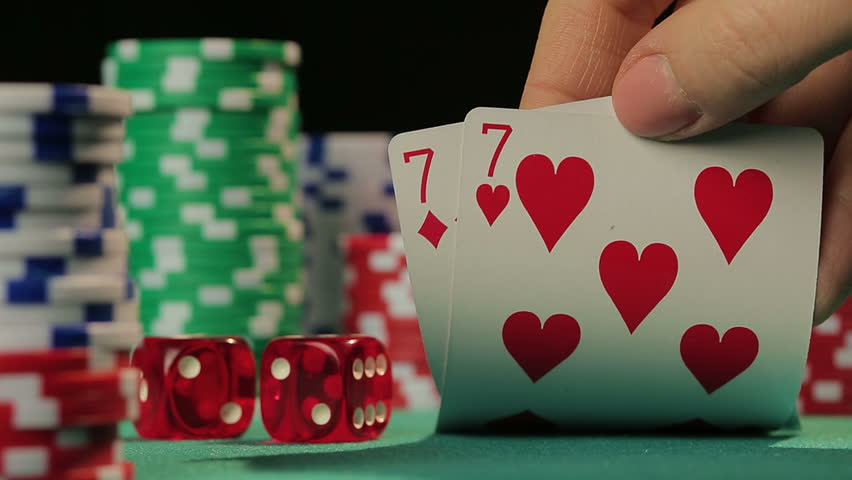 Risky poker player catches pocket pair, gambler hopes to win fortune in casino | Shutterstock HD Video #15582325