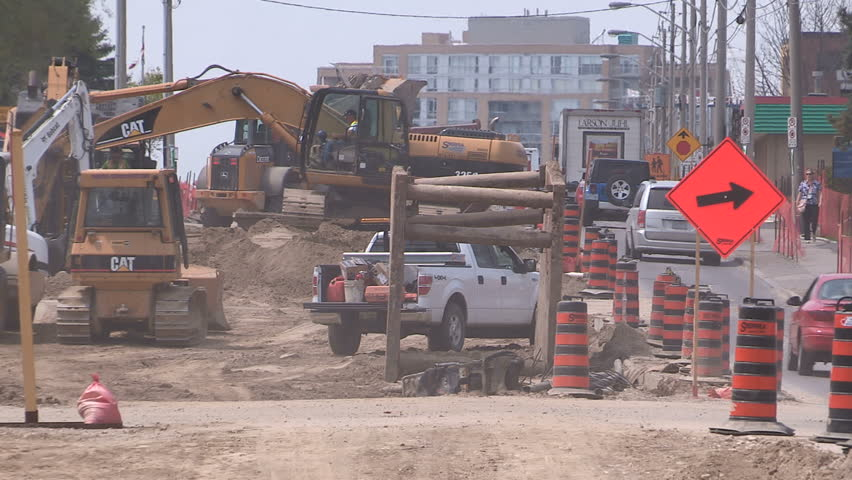 Kitchener, Ontario, Canada June 2015 Summer road construction in the city streets on a hot summer afternoon  - HD stock footage clip