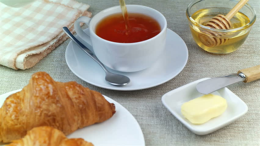 Tea being poured into cup, breakfast time - HD stock footage clip