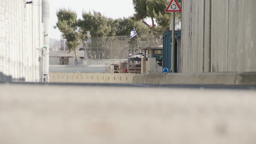 WEST BANK BARRIER, PALESTINIAN OCCUPIED TERRITORIES, ISRAEL - APRIL 1, 2008: Israeli West Bank separation wall, view under barrier, zoom out - HD stock footage clip