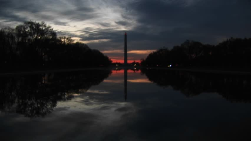 At golden hour, nature creates a perfect mirror image of the Washington Monument and its environs. - HD stock video clip
