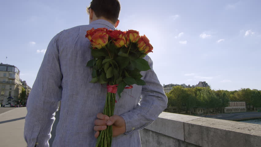 Young man gives his lady a bunch of roses and a big kiss while in Paris- Paris, France   Shutterstock HD Video #15692746