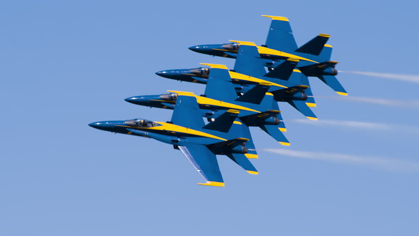 NORTH KINGSTOWN, RHODE ISLAND - CIRCA JUNE 2014:  Navy Blue Angels demonstration team in F18 Hornet fighter jets performing during air show. Beautiful shot of four jets flying close to each other. 4K.