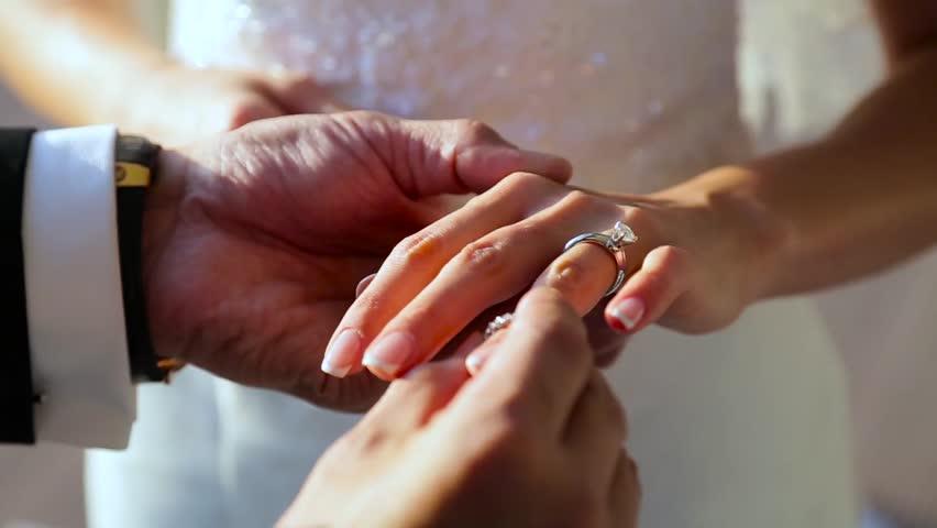 Groom wears a bride a wedding ring. - HD stock video clip