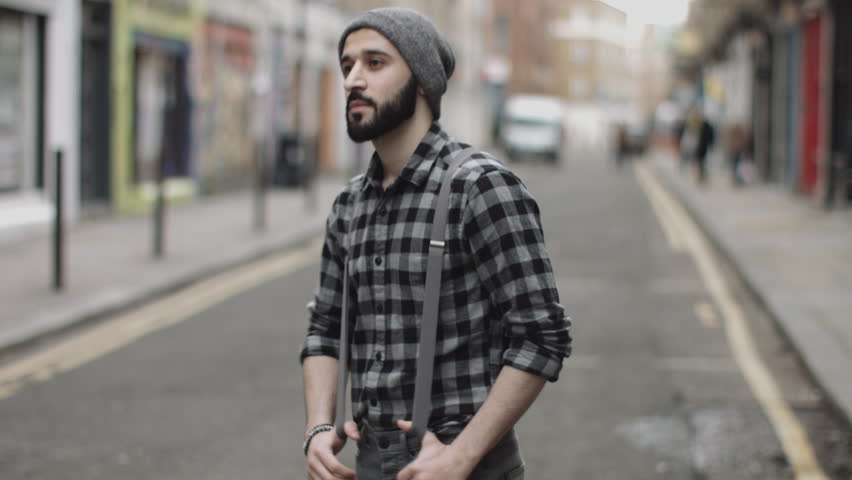 Portrait of Hipster male in street looking to camera, London, England