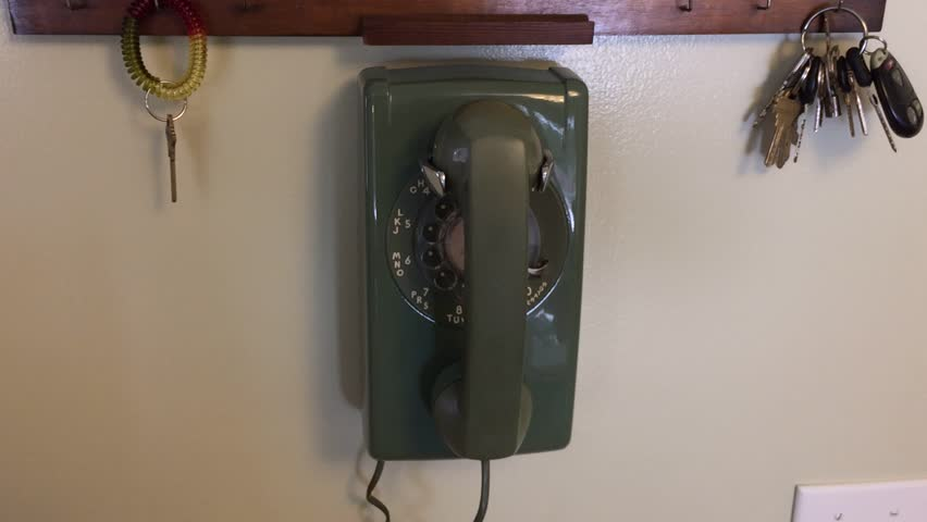 Wall mounted rotary phone footage - dialing a number  - HD stock footage clip