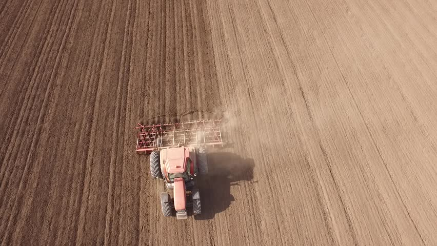 Tractor cultivating arable land for seeding crops, aerial view | Shutterstock HD Video #15762010