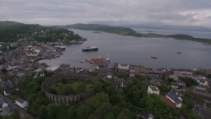 Aerial shot of McCaigs tower in Oban on the west coast of Scotland - HD stock video clip