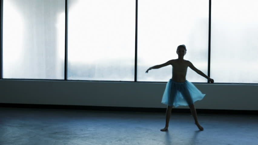 Young Caucasian European girl ballet dance school indoors window silhouette tulle dress barefoot ballerina training pirouette | Shutterstock HD Video #15861838