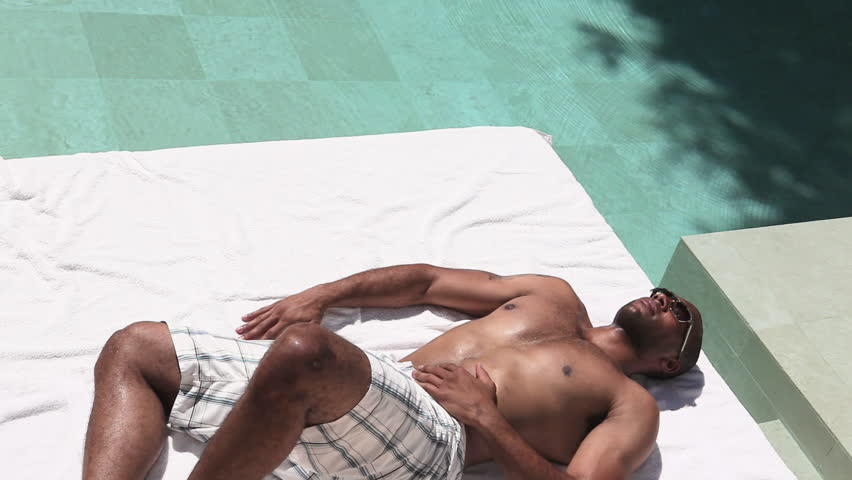 September 14, 2010: Young couple lying by swimming pool #15867931