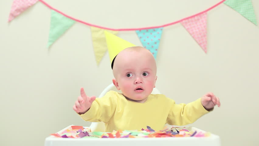 June 02, 2010: Baby boy sitting in highchair with bunting   Shutterstock HD Video #15872557