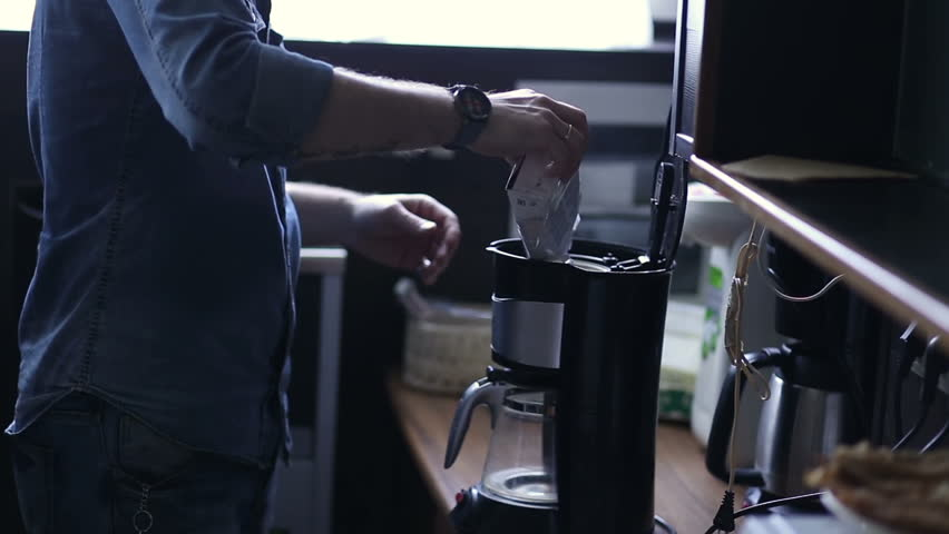 A man prepares a coffee in the coffee machine - HD stock footage clip