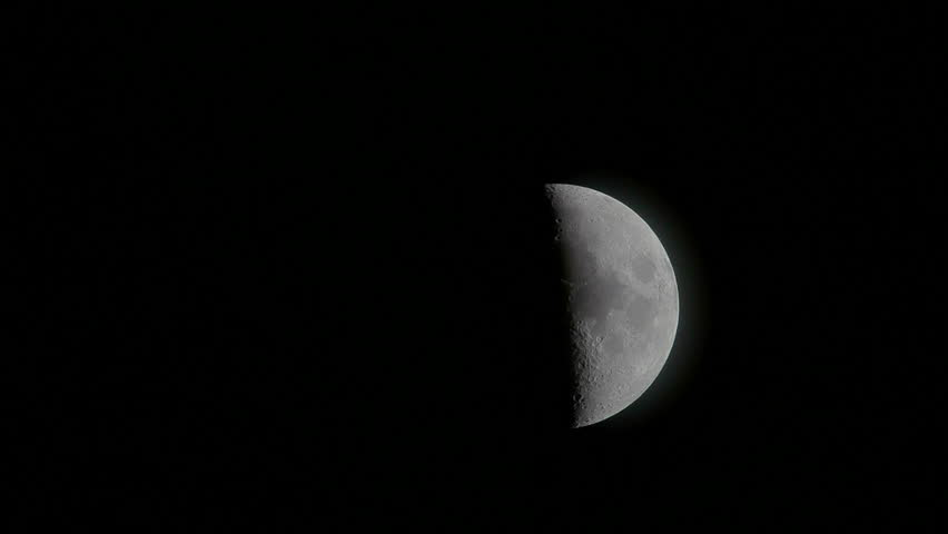 Time lapse of an large moon as it rises in the black night sky. - HD stock footage clip
