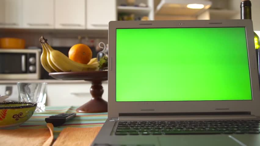 Laptop with green screen on the kitchen table | Shutterstock HD Video #15931597