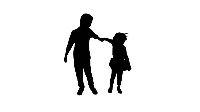 silhouette of a little boy in a baseball cap standing with