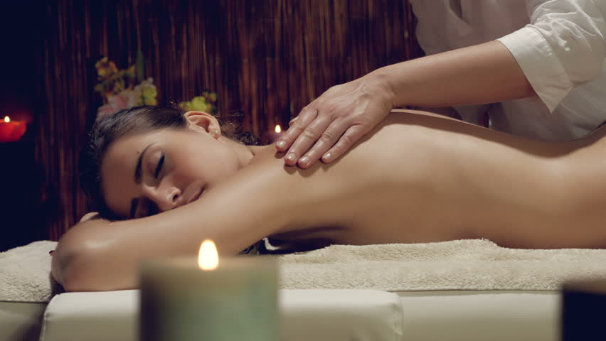 Woman getting massage in spa in hotel in vacation - 4K stock video clip
