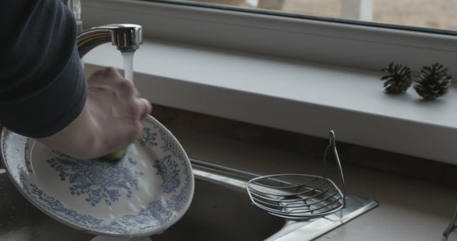 Woman washing dishes in the sink | Shutterstock HD Video #15975400