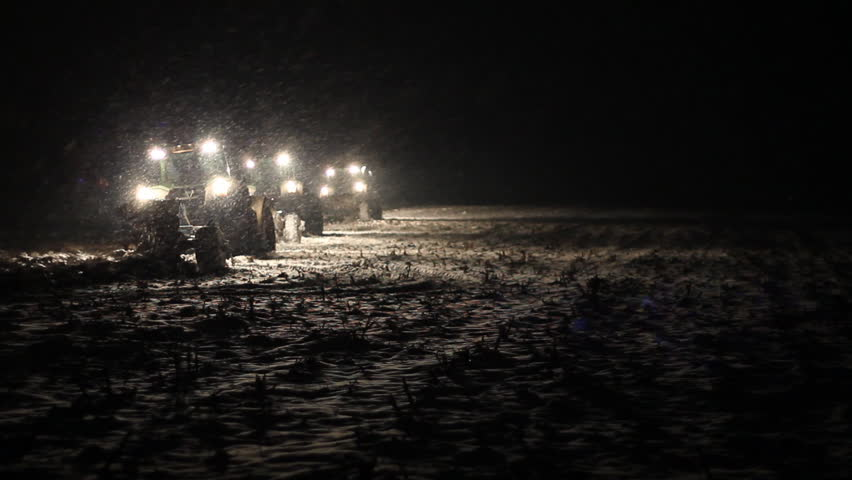 Three tractors plowing at night - HD stock video clip