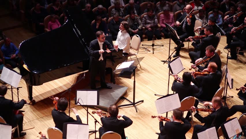 MOSCOW - APR 20, 2015: Conductor at concert devoted to 100th anniversary of David Ashkenazy in House of Music, Svetlanov hall - HD stock video clip