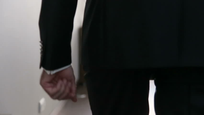 Groom in black wedding suit puts hand into the pocket and walks away. Wedding concept. Slow motion shot | Shutterstock HD Video #16073014