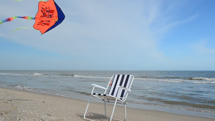 beach chaise lounge and kite hd stock footage clip calm chaise lounge chairs