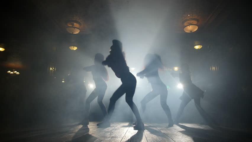 Silhouettes of girls dancing in a night club | Shutterstock HD Video #16108915