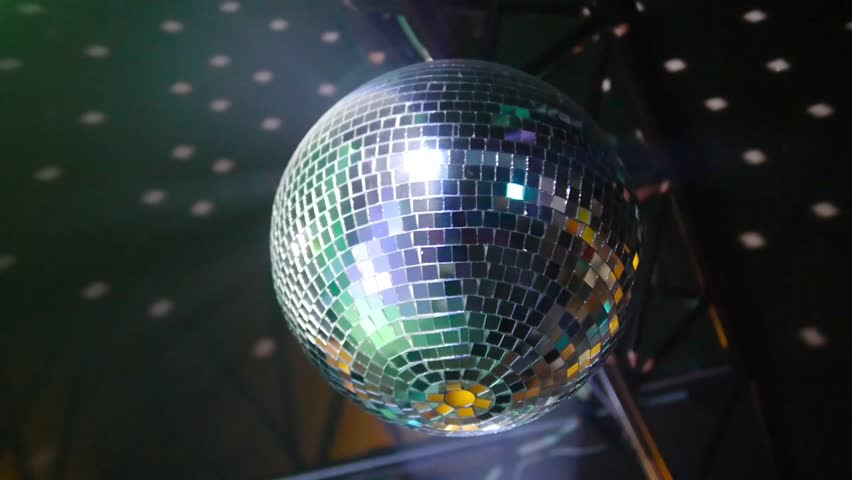 Mirror ball rotates on ceiling in night club. | Shutterstock HD Video #16131856