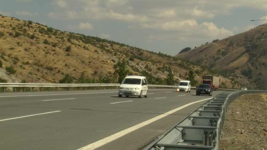 vehicles in the highway cruising - HD stock video clip