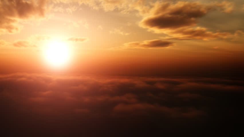 Aerial pan shot over clouds during beautiful sunset  - HD stock video clip