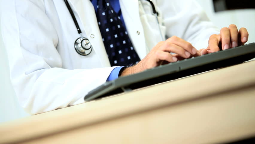 Senior Male Medical Consultant with Computer - HD stock footage clip