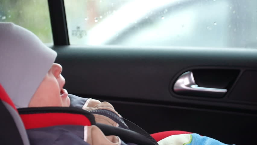 Footage mom takes son from the child seat of the car. HD video | Shutterstock HD Video #16284892