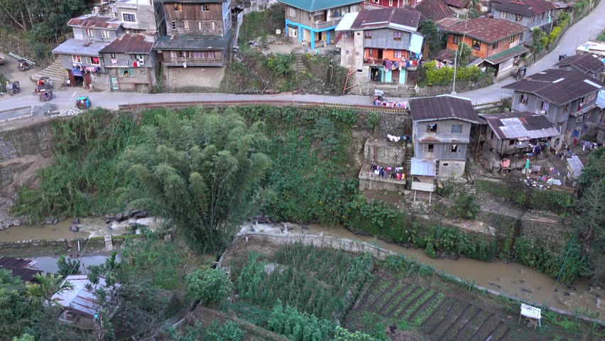 Banaue, Philippines - Jan 2, 2016: Many houses located on the hill with many trees in Banaue, Philippines.