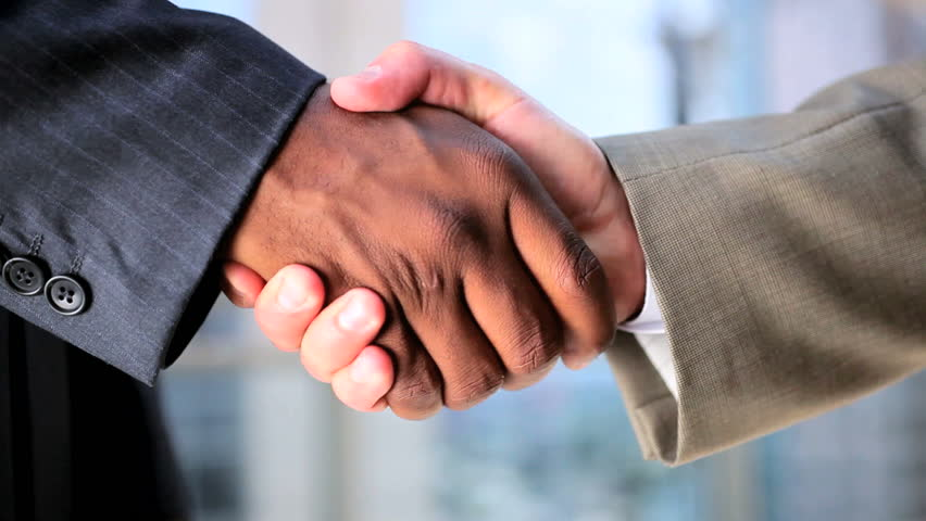 City Businessmen Shaking Hands on Business Deal
