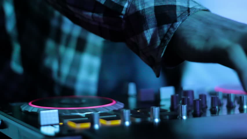 Hands of DJ which mixes music tracks PC mixer in nightclub loop video 7 - HD stock video clip