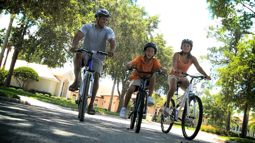 Young Ethnic Family Cycling Together - HD stock video clip