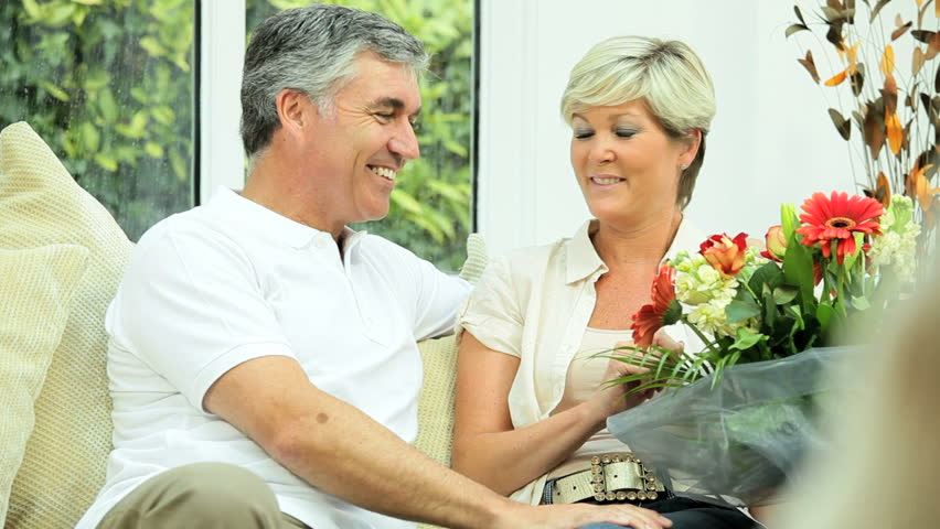 Attractive Mature Lady with Anniversary Bouquet - HD stock footage clip
